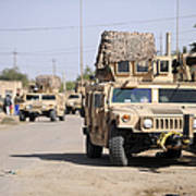 Humvees Conduct Security Poster by Stocktrek Images