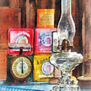 Hurricane Lamp And Scale Poster by Susan Savad