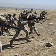 Iraqi Army Soldiers Move To Positions Poster by Stocktrek Images