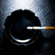 Lit Cigarette And Ashtray On Stainless Steel. Poster by Ballyscanlon