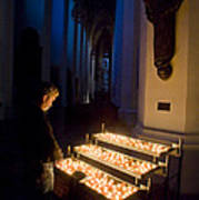 Man Prays By Candles At Frauenkirche Poster by Greg Dale