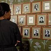 Michelle Obama Looks At Pictures Poster by Everett
