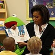 Michelle Obama Reads The Cat In The Hat Poster by Everett