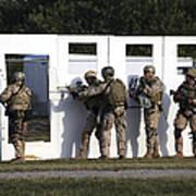 Military Reserve Members Prepare Poster by Michael Wood