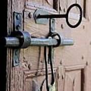 Old Door Of Wood With Its Worn Lock Poster by Bernard Jaubert