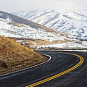 Road Through A Snowy Mountain Landscape Poster by Thom Gourley/Flatbread Images, LLC