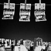 Three Twenty Pounds Sterling Banknotes Hanging On A Washing Line With Blue Sky Above A City Skyline Poster by Joe Fox