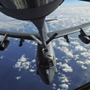 A Kc-135 Stratotanker Aircraft Refuels Poster by Stocktrek Images
