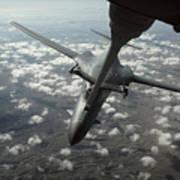 A U.s. Air Force Kc-10 Refuels A B-1b Poster by Stocktrek Images