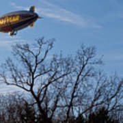 Blimp Over Wingfoot Poster by Tim Fitzwater