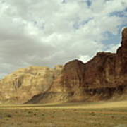 Sparse Tussock And Rock Formations In The Wadi Rum Desert Poster by Sami Sarkis