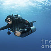 Technical Diver With Equipment Swimming Poster by Karen Doody