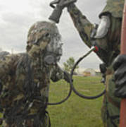 U.s. Air Force Soldier Decontaminates Poster by Stocktrek Images