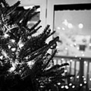 decorated christmas tree looking out of window to snow covered scene in small rural village of Forge Print by Joe Fox