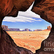 A Peek Into Monument Valley Print by Sandra Bronstein