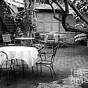 Courtyard Seating Print by John Rizzuto