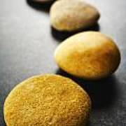 Curving Line Of Brown Pebbles On Dark Background Print by Colin and Linda McKie
