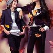 Fashionably Dressed Boy And Teenage Girl Under Falling Autumn Le Print by Oleksiy Maksymenko
