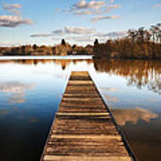 Landscape Of Fishing Jetty On Calm Lake At Sunset With Reflectio Print by Matthew Gibson