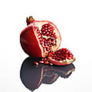 Pomegranate Opened Up On Reflective Surface Print by Johan Swanepoel