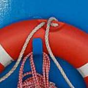 Red Life Belt On Blue Wall Print by Ulrich Kunst And Bettina Scheidulin