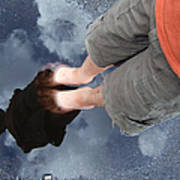 Reflection Of Boy In A Puddle Of Water Print by Matthias Hauser