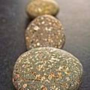Straight Line Of Speckled Grey Pebbles On Dark Background Print by Colin and Linda McKie