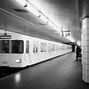 u-bahn train pulling in to ubahn station Berlin Germany Print by Joe Fox