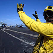 An Aviation Boatswains Mate Directs Print by Stocktrek Images
