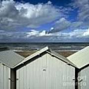 Beach Huts Under A Stormy Sky In Normandy Print by Bernard Jaubert