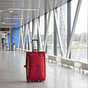 Rolling Luggage In An Airport Concourse Print by Jaak Nilson