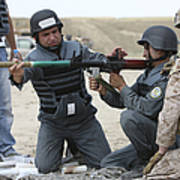 An Afghan Police Student Loads A Rpg-7 Print by Terry Moore
