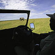 A Guide In A Jeep Observing An African Print by Michael Melford