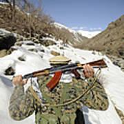 A Mujahadeen Guard Walks With U.s Print by Stocktrek Images