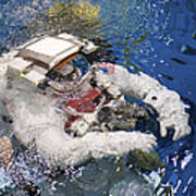 An Astronaut Is Submerged In The Water Print by Stocktrek Images