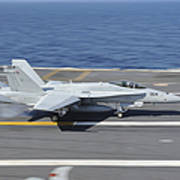 An Fa-18c Hornet Lands Aboard Uss Print by Stocktrek Images