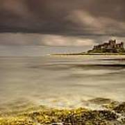 Bamburgh Castle Under A Cloudy Sky Print by John Short