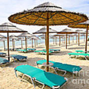 Beach Umbrellas On Sandy Seashore Print by Elena Elisseeva