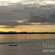 Boat On River At Sunset Print by Nawarat Namphon