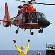 Boatswain Mate Directs A Hh-65a Dolphin Print by Stocktrek Images