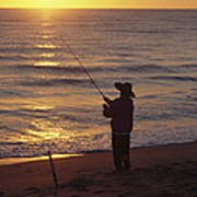 Fishing At Sunrise Print by Raymond Gehman