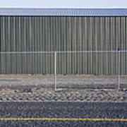 Metal Storage Shed Behind Fence Print by Paul Edmondson