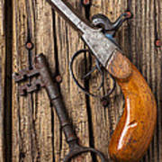 Old Pistol And Skeleton Key Print by Garry Gay