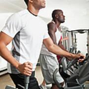 People Exercising In Health Club Print by Erik Isakson