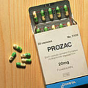 Prozac Pack With Pills On Wooden Surface Print by Damien Lovegrove