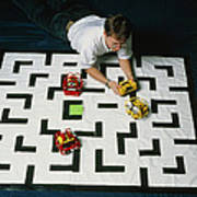 Researcher Testing Lego Robots Playing Pacman Print by Volker Steger