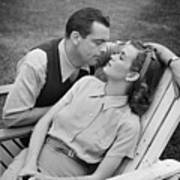 Romantic Couple Relaxing On Deckchair, (b&w) Print by George Marks
