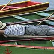 Tour Boat Guide Naps Amidst Rowboats Print by Raymond Gehman