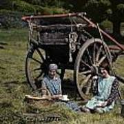 Two Girls Eat Lunch In A Hayfield Print by Clifton R. Adams