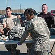 Us Army First Responders Use A Table Print by Everett